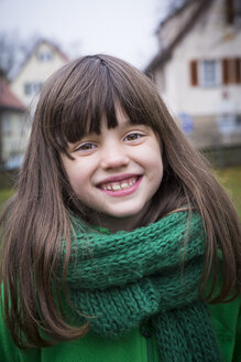 Portrait of smiling girl wearing green scarf - LVF002415