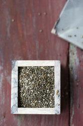 Little box of chia, Salvia hispanica, on wood - MYF000746