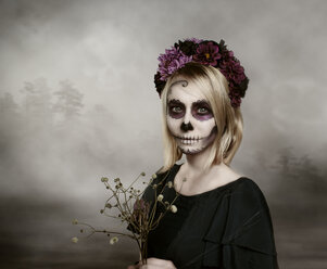 Portrait of woman with sugar skull makeup - NIF000024