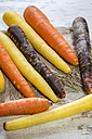 Different organic carrots on wood - SARF001127