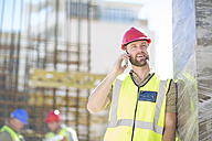 Smiling construction worker on cell phone - ZEF001597