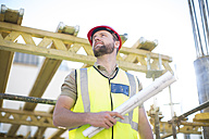 Construction worker looking at construction site - ZEF001654