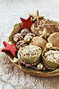 Bowl of different oat pastries and Christmas decoration - EVGF001396