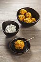 Bowl of vegetarian oat fritters and dip - EVGF001401