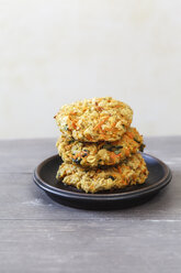 Plate with stack of three vegetarian oat fritters - EVGF001404