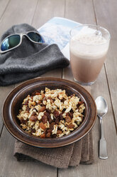 Plate of homemade granola and glass of cocoa - EVGF001405
