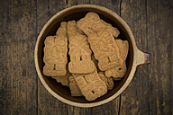 Bowl of almond biscuits on wood - LVF002440