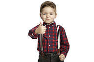 Little boy with thumb up wearing suspenders pouting mouth - GDF000632
