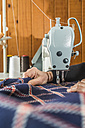 Close-up of woman sewing with a sewing machine - DEGF000027