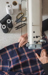 Close-up of woman sewing with a sewing machine - DEGF000028