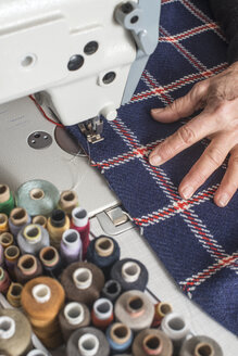 Close-up of woman sewing with a sewing machine - DEGF000029