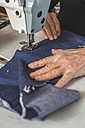 Close-up of woman sewing with a sewing machine - DEGF000030
