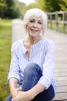 Portrait of smiling white haired senior woman - VRF000134