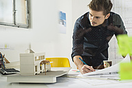 Young architect working in office - UUF002777