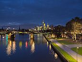 Germany, Frankfurt, River Main with Ignatz Bubis Bridge, skyline of finanial district in background - AM003411
