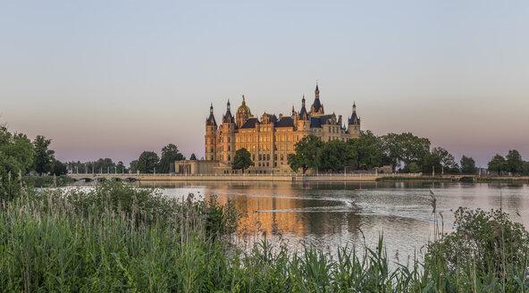 Germany, Mecklenburg-Vorpommern, Schwerin, Schwerin Castle at dusk - PVCF000251