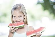 Portrait of little girl eating watermelon - ZEF002738