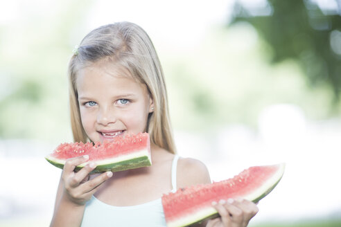 Portrait of little girl eating watermelon - ZEF002738