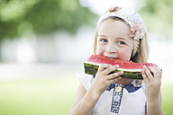 Portrait of little girl with hair-band eating watermelon - ZEF002751