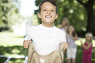 Boy competing in a sack race - ZEF002796