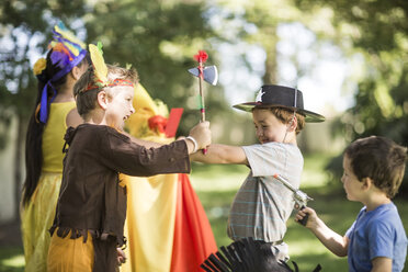 Kids in garden playing Cowboys and Indians - ZEF003226