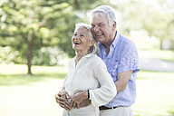 Happy senior couple outdoors - ZEF003494