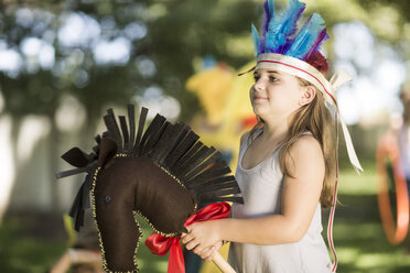 Girl in garden playing Cowboys and Indians - ZEF002802