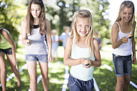 Girl competing in an egg-and-spoon race - ZEF003230