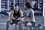 Athlete with trainer in gym having a break - ZEF002634