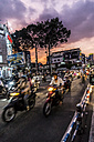 Vietnam, Ho Chi Minh City, motorcycles on the street at dusk - WE000311