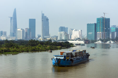 Vietnam, Ho Chi Minh City, ship on Saigon River and skyscrapers with Bitexco Financial Tower - WEF000308