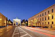 Germany, Bavaria, Munich, Ludwigstrasse with Siegestor at blue hour - BRF000880