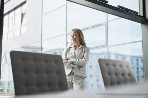 Confident businesswoman in conference room - RBF002105