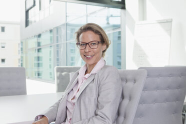 Smiling businesswoman in conference room - RBF002150