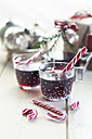 Glasses of mulled wine, candy canes and Christmas decoration - SBDF002165