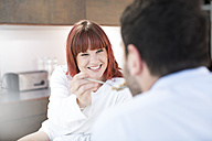 Couple eating in kitchen - ZEF002643