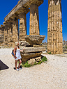 Italy, Sicily, Province of Trapani, Selinunt, female tourist watching the temple E - AMF003451