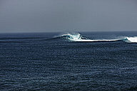 Spain, Canary Islands, Fuerteventura, surf on the sea - STKF001101