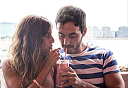 Young couple drinking a milkshake - MGOF000001