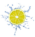 Slice of lemon with water splash in front of white background - RAMF000020