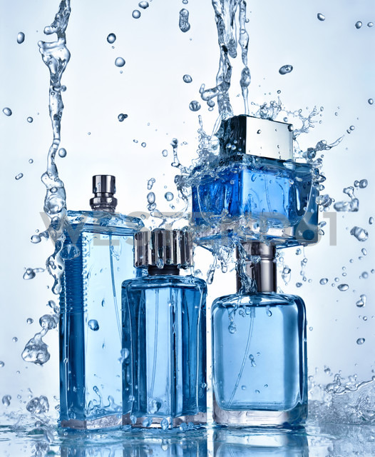 Four perfume bottles under flowing water - RAMF000023