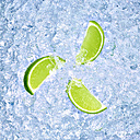 Three slices of lime on crushed ice - RAMF000026