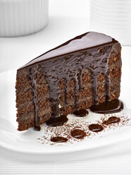 Piece of cream chocolate cake on white plate - RAMF000031