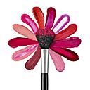 Lipstick and nail polish strokes forming with powder brush a flower shape - RAMF000034