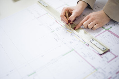 Close-up of architect working on construction plan - UUF002926