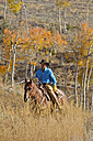 USA, Wyoming, Big Horn Mountains, riding cowboy in autumn - RUEF001330