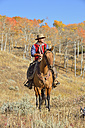 USA, Wyoming, Big Horn Mountains, riding cowboy in autumn - RUEF001308