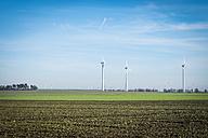 Germany, Saxony-Anhalt, Mansfelder Land, wind turbines on field - ABAF001594
