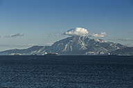 Spain, Andalusia, Tarifa, cargo ships passing Strait of Gibraltar in front of Mount Moses - KBF000257