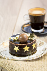 Small chocolate cake and cup of espresso - JUNF000116